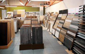 Assortment of laminated flooring samples in hardware store | Great Lakes Carpet & Tile